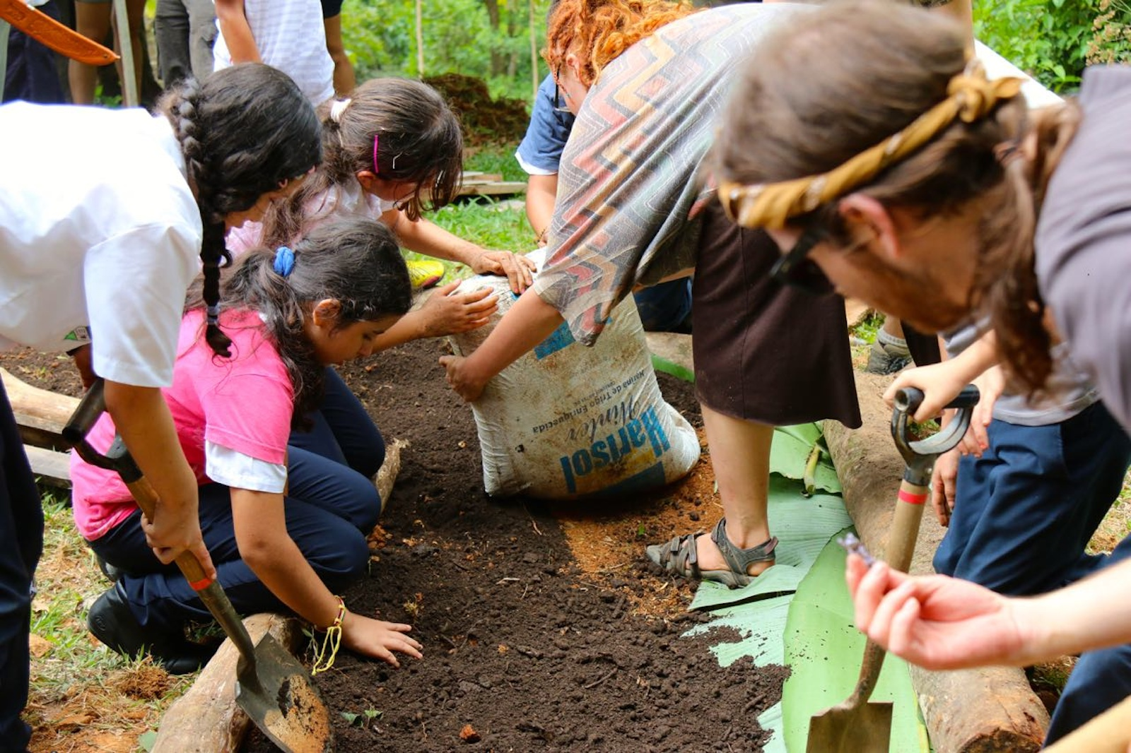 Envision Action Day Students Gardening