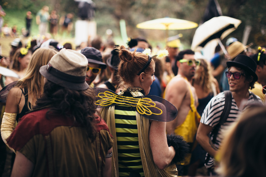 a woman in a bee costume among many others in other costumes